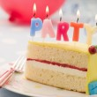 Party Candles on a Slice of Birthday Cake — Stock Photo