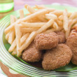 Chicken Nuggets with Spaghetti Hoops and Chips — Stock Photo