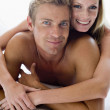 Couple lying in bed smiling — Stock Photo #4767679