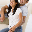 Royalty-Free Stock Photo: Couple in living room laughing