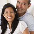 Couple in living room smiling — Stock Photo #4767781