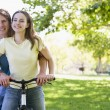 Couple on a bike outdoors smiling — Stock Photo