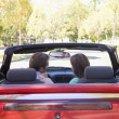 Couple in convertible car — Stock Photo