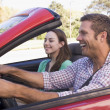 Couple in convertible car smiling — Stock Photo #4767895