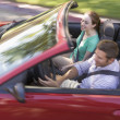 Couple in convertible car smiling — Stock Photo #4767898