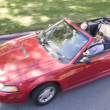 Couple in convertible car smiling — Stock Photo #4767899