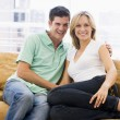 Royalty-Free Stock Photo: Couple in living room smiling