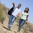 Couple walking on path holding hands and smiling — Foto de Stock