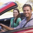 Couple in convertible car smiling — Stockfoto