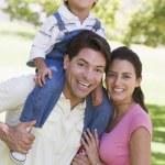 Family outdoors smiling — Stock Photo