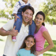 Family outdoors smiling — Stock Photo