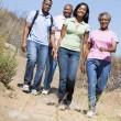 Two couples walking on path smiling — Stock Photo #4768092