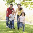 Stok fotoğraf: Family running outdoors smiling