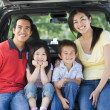 Family sitting in back of van smiling — Stock Photo #4768164