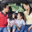 Family sitting in back of van smiling — Stock Photo #4768165