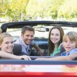 Family in convertible car smiling — Stock Photo #4768184
