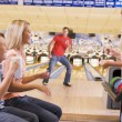 Family in bowling alley smiling — Stock Photo
