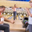 Family in bowling alley cheering and smiling — Stock Photo #4768201