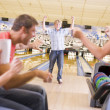 Family in bowling alley cheering and smiling — Stock Photo #4768202