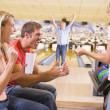 Family in bowling alley cheering and smiling — Stock Photo #4768203