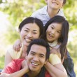 Family lying outdoors smiling — Stock Photo #4768240