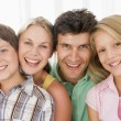 Family in living room smiling — Stock Photo #4768255