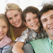 Family in living room smiling — Stock Photo #4768256