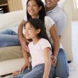 Family in living room smiling — Stock Photo #4768369