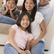 Family in living room smiling — Stock Photo #4768371