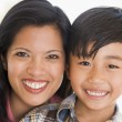 Woman and young boy smiling — Stock Photo