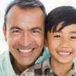 Man and young boy smiling — Stock Photo