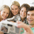 Family taking self portrait with digital camera — Stock Photo #4768497