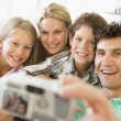 Stock Photo: Family taking self portrait with digital camera