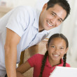 Man and young girl with laptop in dining room smiling — Stock Photo