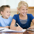 Two young children with laptop doing homework in dining room smi — Stock Photo #4768683