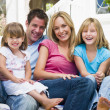 Family sitting on patio smiling — Stock Photo #4768735