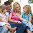 Stock Photo: Family sitting on patio smiling