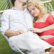 Couple sleeping in hammock — Stock Photo