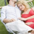 Stock Photo: Couple sleeping in hammock