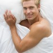 Man lying in bed smiling — Stock Photo #4768938