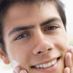 Man applying shaving cream smiling — Stock Photo #4768974