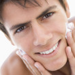 Man putting on shaving cream smiling — Stock Photo #4768994
