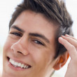Man playing with hair smiling — Stock Photo #4769005
