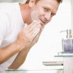Man in bathroom washing face — Stock Photo #4769119