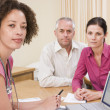 Doctor with laptop and couple in doctor's office — Stock Photo