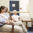 Five waiting in waiting room - Stock Photo