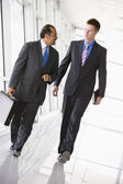 Businessmen walking through lobby — Stock Photo