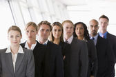 Group of office workers lined up — Stock Photo