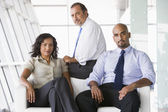 Group of businesspeople in lobby — Stock Photo