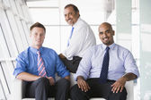 Group of businessmen sitting in lobby — Stock Photo